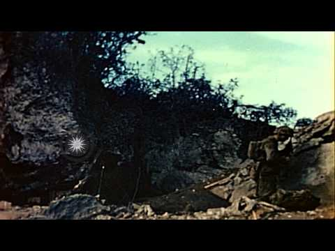 US Marines throw flame throwers and grenades into caves in Saipan, Mariana Island...HD Stock Footage
