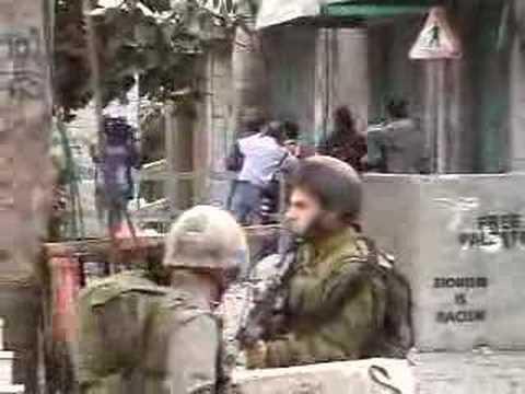 Palestinian teenager being held as human shield