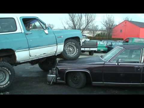 K5 Blazer driving OVER a CADILLAC FLEETWOOD