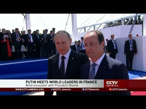 At D-Day 70th anniversary, Putin meets world leaders