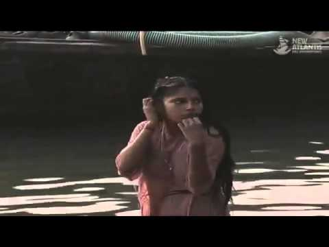 girl is bathing on river side wear pink dress  with deep cleavage