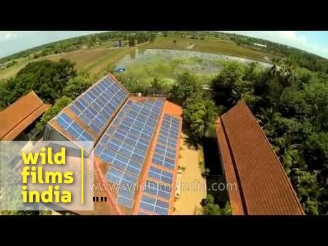 Solar panel installation on building roof-top in Asia