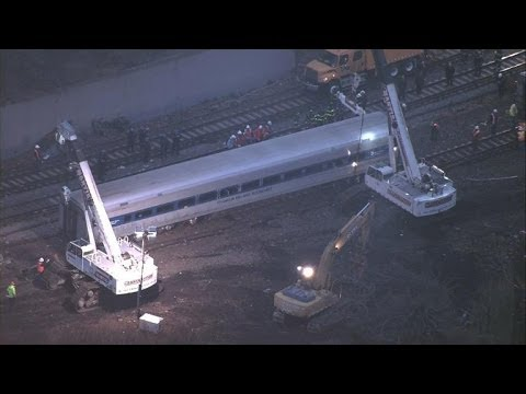 Cranes start moving derailed Bronx commuter train cars