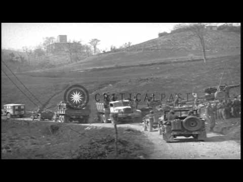 US soldiers aboard military vehicles passing through the jammed road in Italy. HD Stock Footage