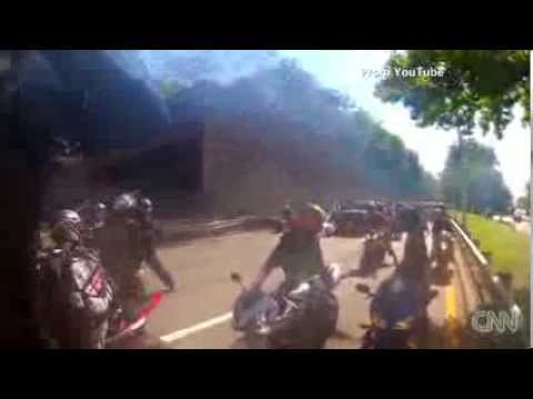 Driver runs over biker, gets attacked by other bikers