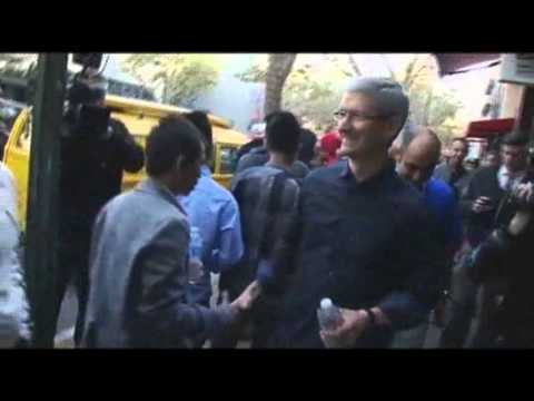 Raw: Apple CEO Tim Cook Surprises iPhone Crowd