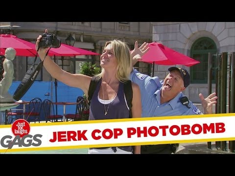 Jerk Cop Photobombs Tourist's Picture