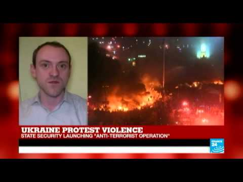 Ukraine: 26 dead in clashes after riot police storm protest camp
