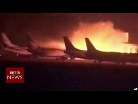 Karachi airport 'gunfire resumes' after deadly raid - BBC News