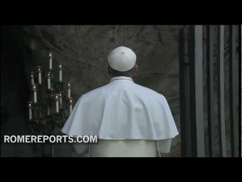 Pope Francis prays before Our Lady of Lourdes at the Vatican