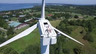 Drone Captures Man Sunbathing on Wind Turbine