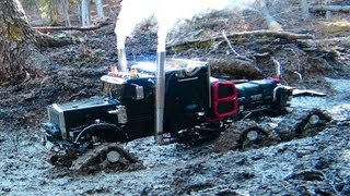 Rc Trucks Pull Each Other Out Of The Mud In Extreme Conditions