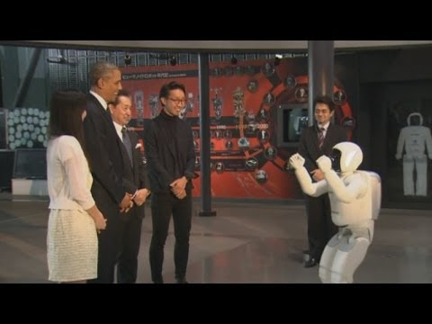 Obama plays soccer with a robot in Japan