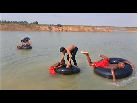 Funny Boys Swimming with Car Tires And Playing In Water Of Pond