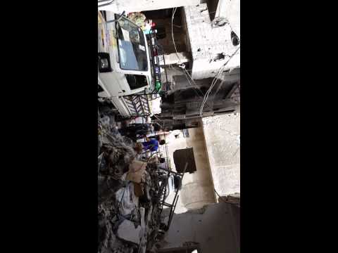 Residents of Yarmouk camp sing for Syrian preaident and army