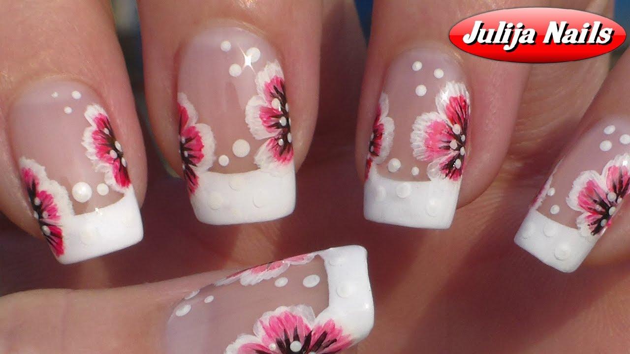 Фото нарисованных цветов на ногтях