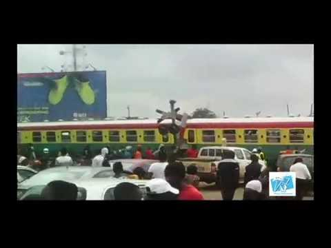 train driver demonstrate against bad economy by blocking road (Ghana)