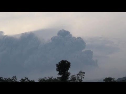 Two dead, flights disrupted as Indonesia volcano erupts