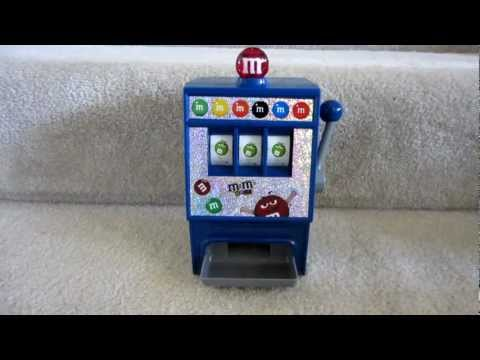 M&M's World Slot Machine Candy Dispenser, Quick demo video of an M&M's slot machine / candy dispenser we picked up from M&M's World in Las Vegas for $22. Measures 9 1/2 inches tall and uses 2xAA batt...