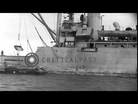 An AK (cargo ship) unloads vehicles on a rhino barge during the Utah Beach landin...HD Stock Footage