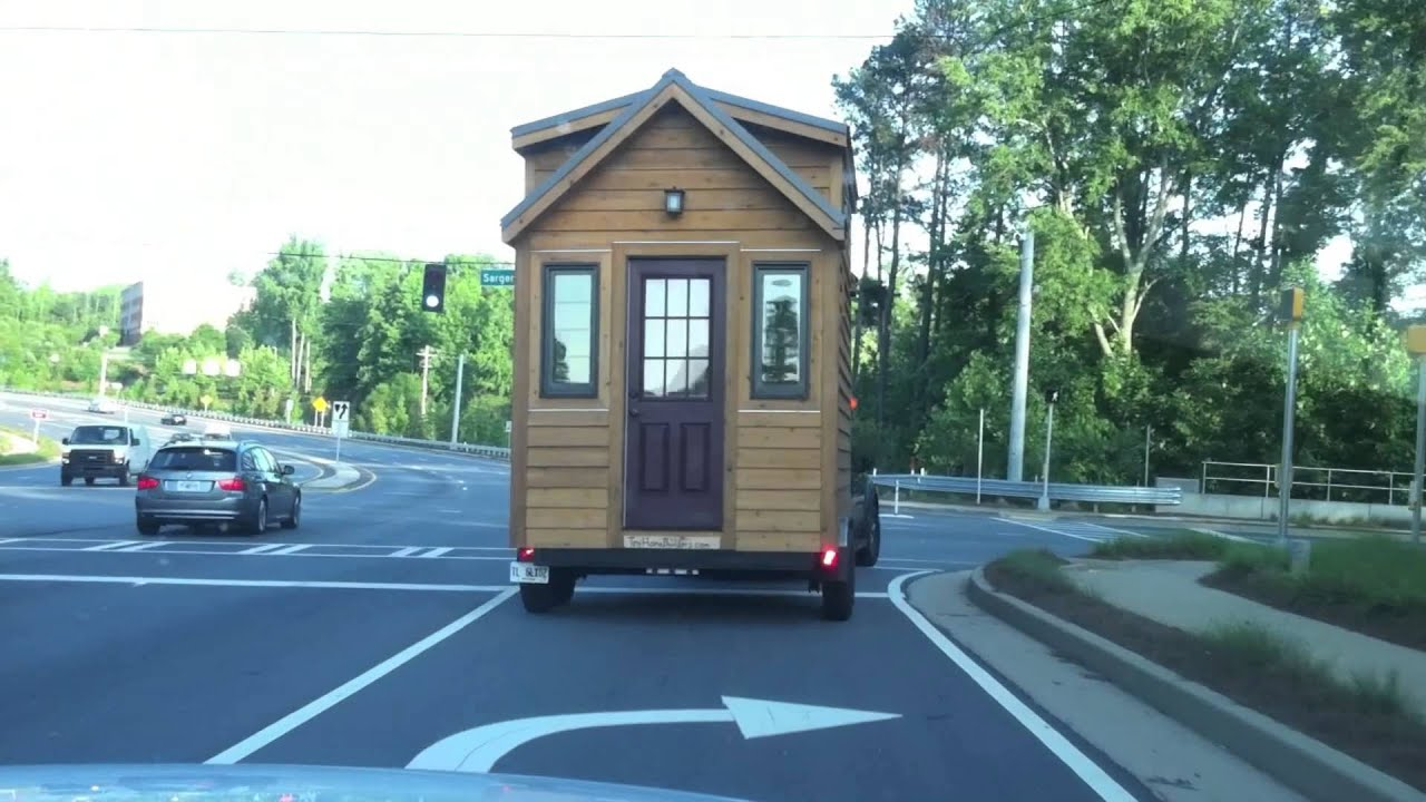 Behind a tiny house on wheels on the road youtube - The house on four wheels ...