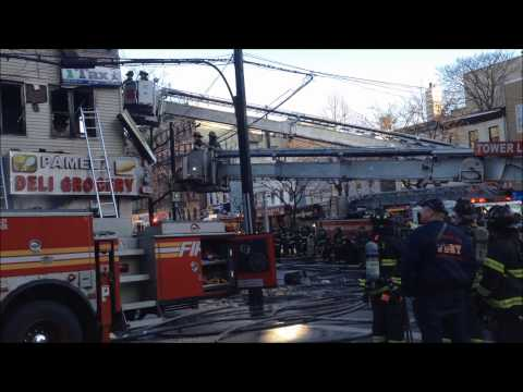 Aerial ladder hits FDNY firefighter in head at house fire