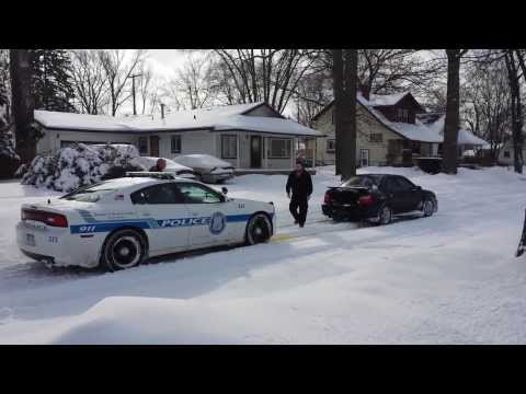 Subaru rescues cruiser from a snow bank