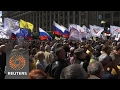 Russian opposition activists rally to mark anniversary of mass anti-Putin protest