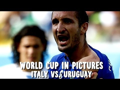 World Cup in Pictures: Uruguay advance, but victory marred by another Luis Suarez bite