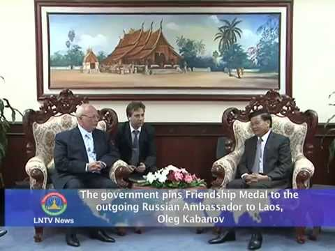 Lao NEWS on LNTV: The Gov.pins Friendship Medal to the outgoing Russian Ambassador.18/6/2014