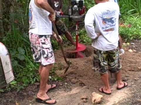 9 26 09 Guam's kitesurfing crew digs post holes - 4th clip