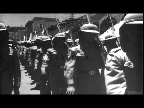 Arab soldiers marching in streets of Jordan during Arab-Israeli War. HD Stock Footage