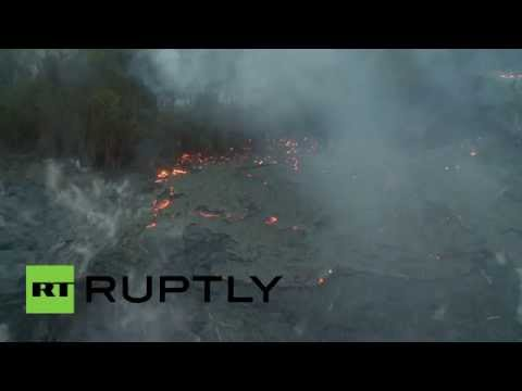 Aerial Video: Slow-moving lava burns through lush forests in Hawaii