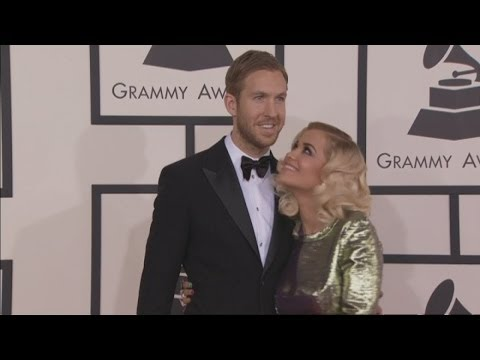 Grammy Awards: Rita Ora and Calvin Harris loved up on the red carpet in LA