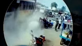 Exclusive Video: Bus hit by truck jumps over highway divider