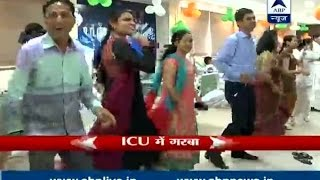 Hospital staff play Garba in ICU with patients watching