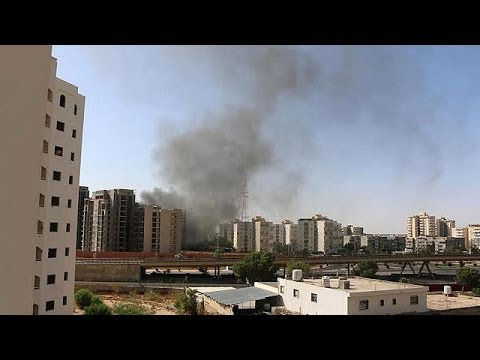 Militias fight over airport in Libya's capital Tripoli