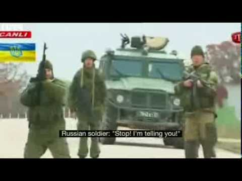 BBC News, Russian troops, fire into air as Ukrainians, march on Crimean airbase.