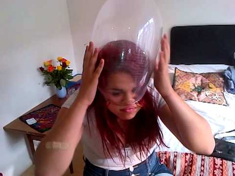 girl putting condom head