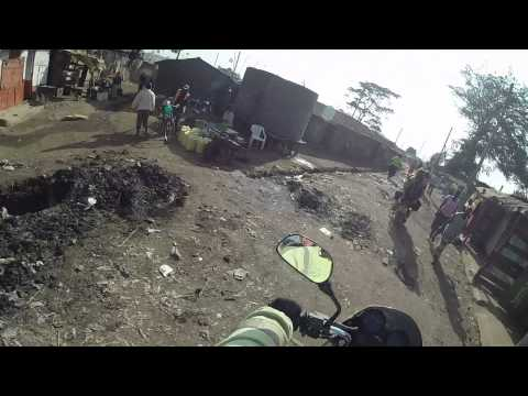 Motorcycle ride into Kibera slum, Kenya