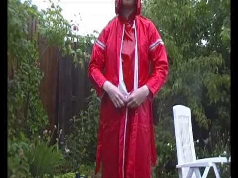 rainwear lady in the garden   with a agu rubber nylon rain raincoat