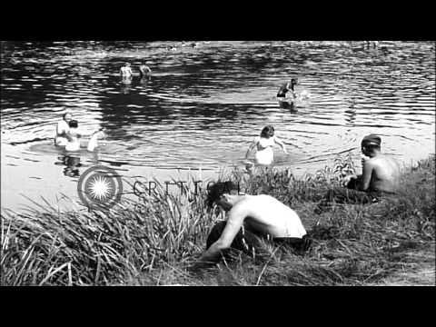 Displaced Russian people washing clothes and bathing in river Mulde in Grimma, Ge...HD Stock Footage