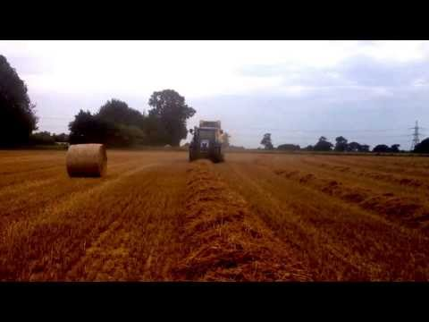 New Holland T6070 baling with a BR7070 baler