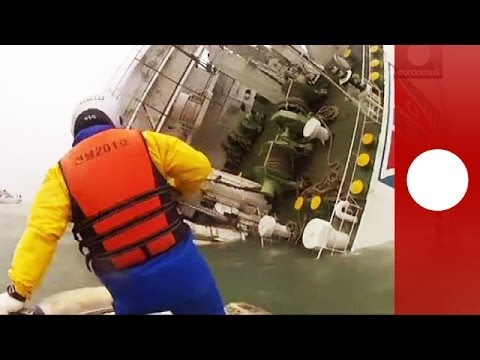 South Korean TV show footage of the sunken passenger ferry, as coaost guard patrols continue their efforts to rescue passengers from it.  The passenger ferry, identified as the Sewol, was carrying 477 people, when it listed badly on its side and capsized as it neared Jeju island, about 100 km (60 miles) south of the Korean peninsula. 164 were confirmed rescued, while two are reported to have died and more than 300 remain unaccounted for.  What is in the news today? Click to watch: http://eurone.ws/1kb2gOl  euronews: the most watched news channel in Europe Subscribe! http://eurone.ws/10ZCK4a  euronews is available in 14 languages: http://eurone.ws/17moBCU  In English: Website: http://www.euronews.com/news Facebook: http://www.facebook.com/euronews Twitter: http://twitter.com/euronews Google+: http://google.com/+euronews VKontakte: http://vk.com/en.euronews