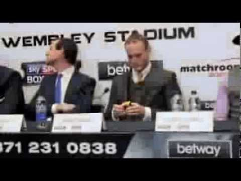 GEORGE GROVES PLAYS HIS 'RUBIK'S CUBE' DURING THE PRESS CONFERENCE (EXCLUSIVE) FROCH v GROVES 2