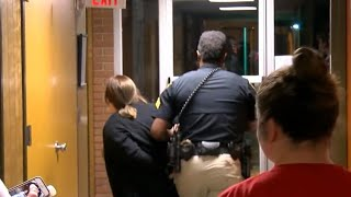 Teacher forcibly removed after questioning superintendent's raise