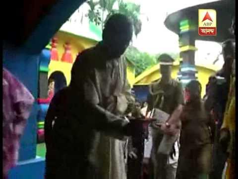 Governor M K Narayanan inaugurates a puja in Baruipur.