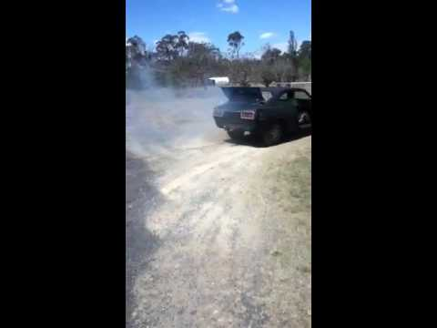 Tiny Corolla burnout V6 engine