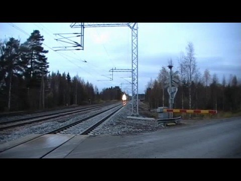 Express train 810 passes Murtomki level crossing