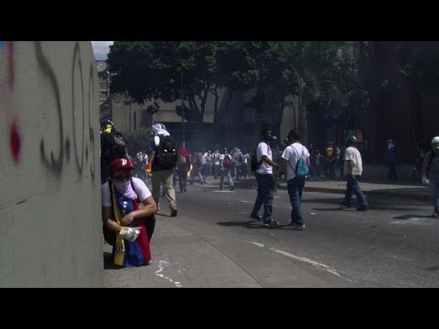 Clashes in Caracas after opposition mayors arrested